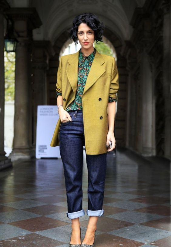 a bright look with navy jeans, a printed shirt, a mustard oversized blazer and printed shoes
