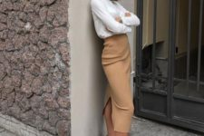 11 a camel high waisted pencil midi, a white turtleneck, white trainers for a casual and chic university outfit