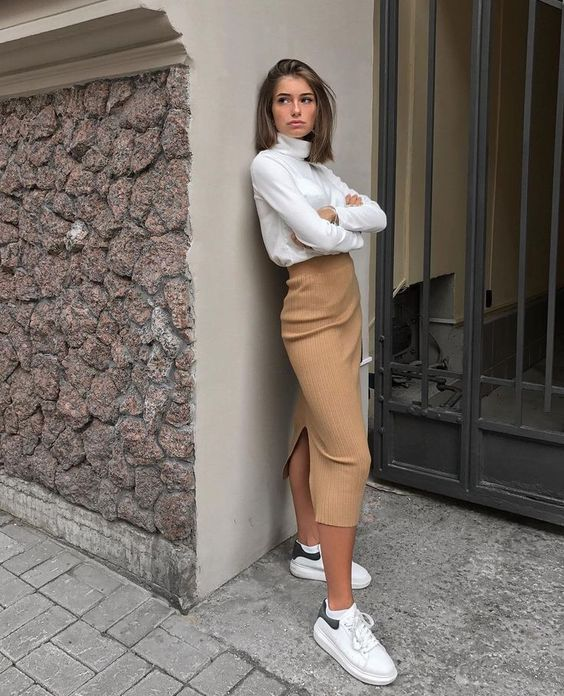 a camel high waisted pencil midi, a white turtleneck, white trainers for a casual and chic university outfit