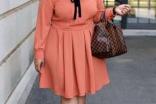 11 a coral knee dress with a black bow, black shoes and a plaid bag for a bright fall office look