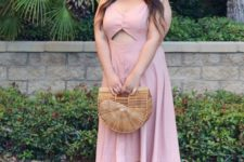 11 a super cute blush midi dress with a front cutout, brown shoes and a wooden bag for a holiday