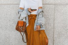 11 a white tee, an ocher pleated midi skirt, brown leather slippers, a straw hat and an oversized denim jacket