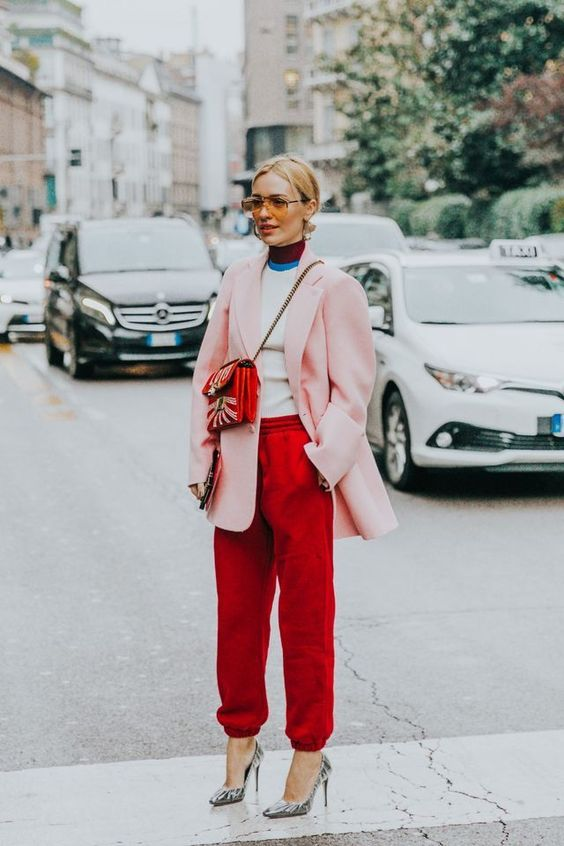 a bright look with red pants, a color block top, an oversized pink blazer, printed shoes and a red bag