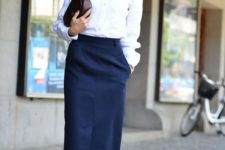 12 a business casual look with a white shirt, a navy pencil midi and matching sneakers plus a clutch