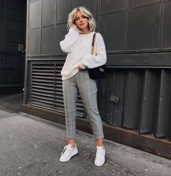 a creamy sweater, plaid cropped pants, white sneakers and a black bag for a casual studies look