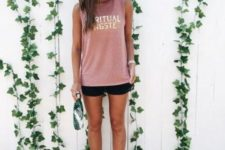 12 a simple and comfy look with a pink sleeveless long top, black shorts, a grey cap and white sneakers