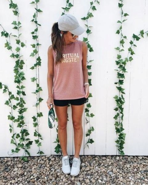 a simple and comfy look with a pink sleeveless long top, black shorts, a grey cap and white sneakers