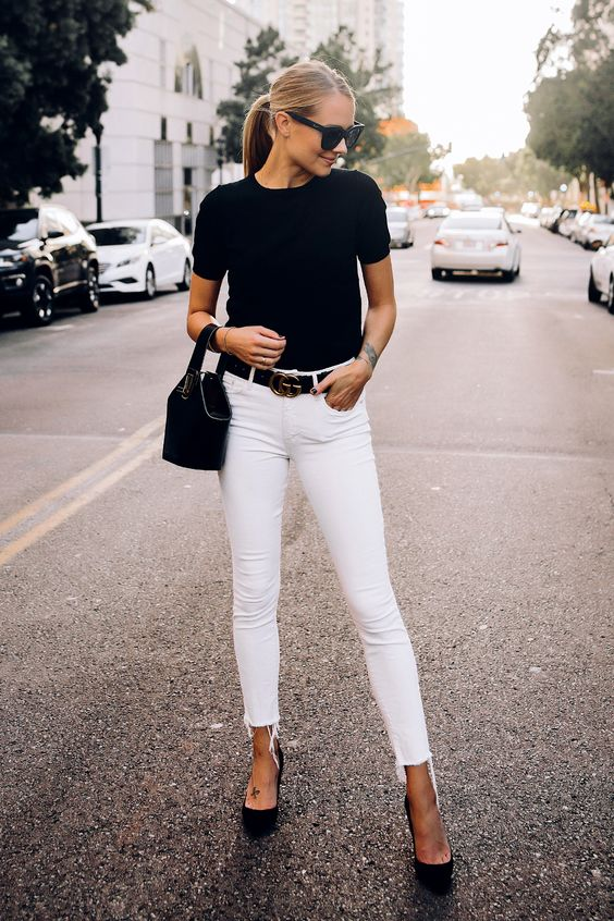 a simple look with white raw hem jeans, a black tee, black heels and a black bucket bag
