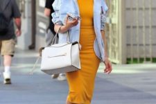 12 a sunny ellow fitting dress, an oversized denim jacket, white sneakers and a creamy bag