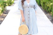 12 a timeless light blue striped midi dress with short sleeves, matching heels and a round wicker bag for a touch of romance
