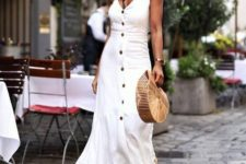 12 a white A-line midi dress with a row of black buttons, two tone shoes and a straw hat for a holiday look