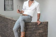12 a white shirt, grey pants, amber loafers with tassels for a chic and refined summer outfit