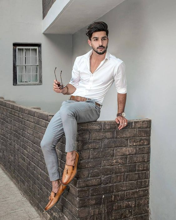 a white shirt, grey pants, amber loafers with tassels for a chic and refined summer outfit
