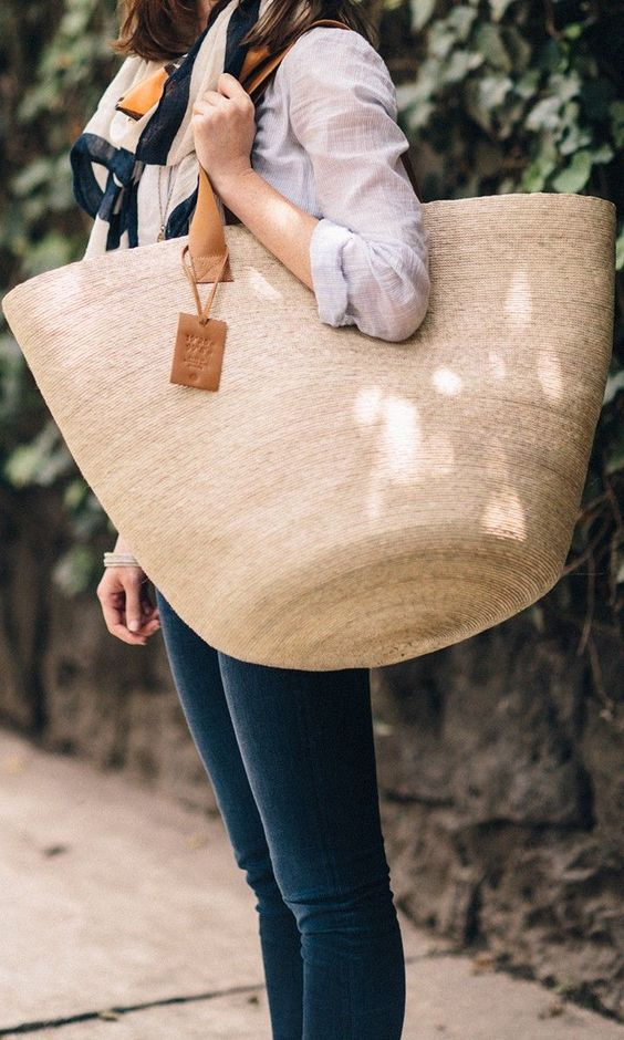 such an oversized straw tote is a great catch all option for spring and summer and for everyday