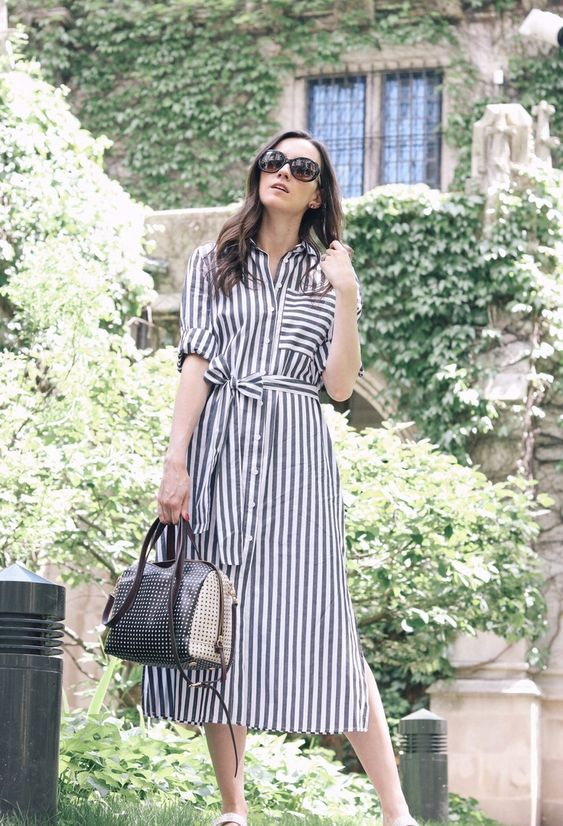 a grey striped midi shirtdress with rolled up sleeves, a comfy bag and metallic shoes for a simple and chic look