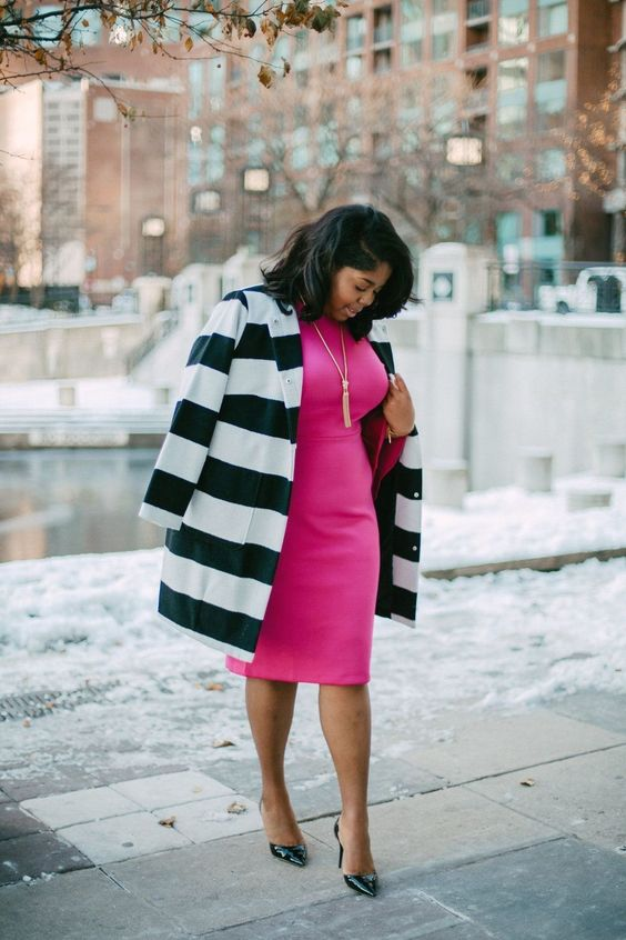 a hot pink fitting knee dress, black shoes and a striped coat for a lively work outfit