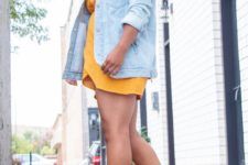 13 a marigold mini dress, light blue shoes and a bleached oversized denim jacket
