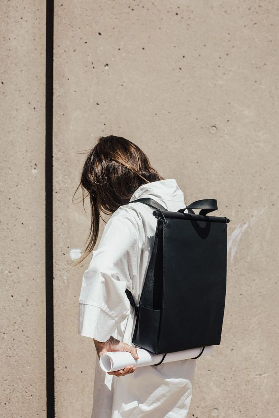 a minimalist black convertible laptop backpack and bag is an ultra-modern idea