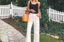 13 a relaxed outfit with straight white jeans with a raw hem, a black top, brown shoes and an amber bag