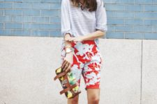 13 a striped grey tee, colorful long shorts, bright ankle strap heels and a matching bag for a mixed print look