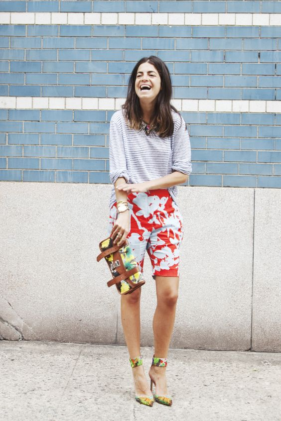 a striped grey tee, colorful long shorts, bright ankle strap heels and a matching bag for a mixed print look