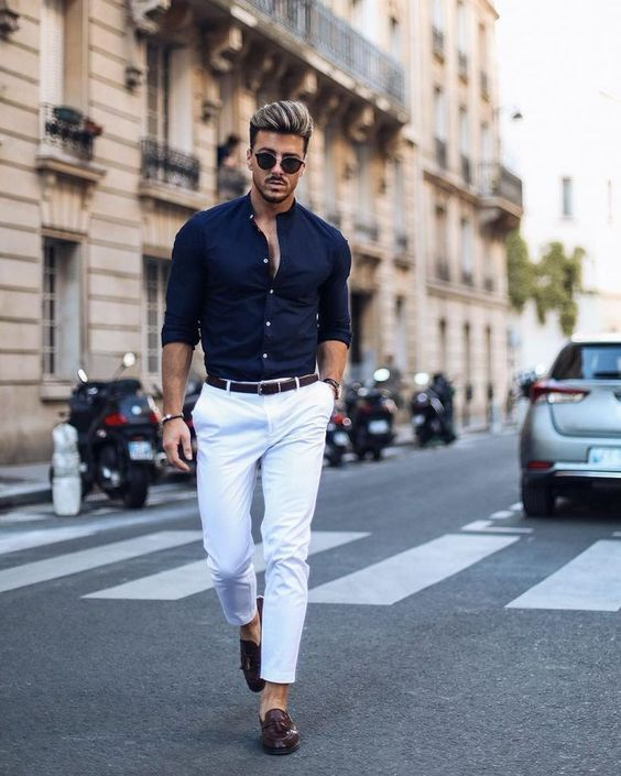 a stylish outfit suitable for parties, white pants, brown moccasins, a navy shirt