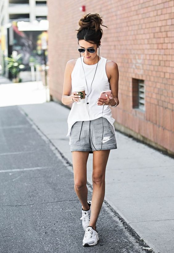 a white sleeveless top, grey shorts and white trainers for comfortable running
