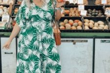 14 a green tropical print maxi wrap dress, statement earrings and a bucket bag for a summer party