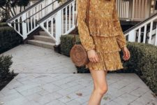 14 a mustard floral mini dress with long sleeves, a wicker round bag, nude platform shoes