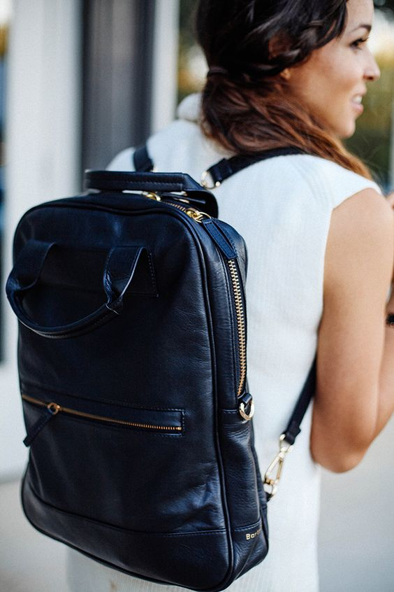 a navy and gold laptop backpack will add a slight touch of color and will be a comfortable option