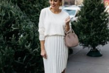 14 a pleated asymmetrical skirt in white, a white top, blush shoes and a small bag for a chic neutral look