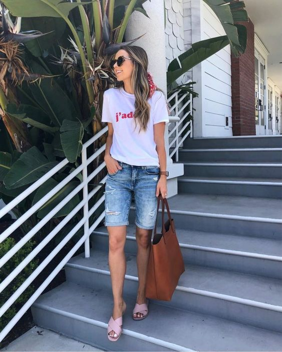 a white printed tee, denim long shorts, pink slippers and a brown shopper bag for every day