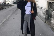 14 a white printed tee, grey plaid pants, black sneakers and a black long cardigan for comfort