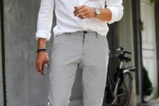 14 a white shirt, grey pants, white sneakers is effortless chic that will be appropriate for more formal parties