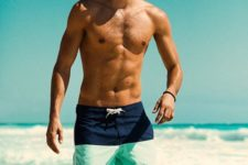 14 bright color block swim trunks with a navy and mint green part is a sporty and bright option