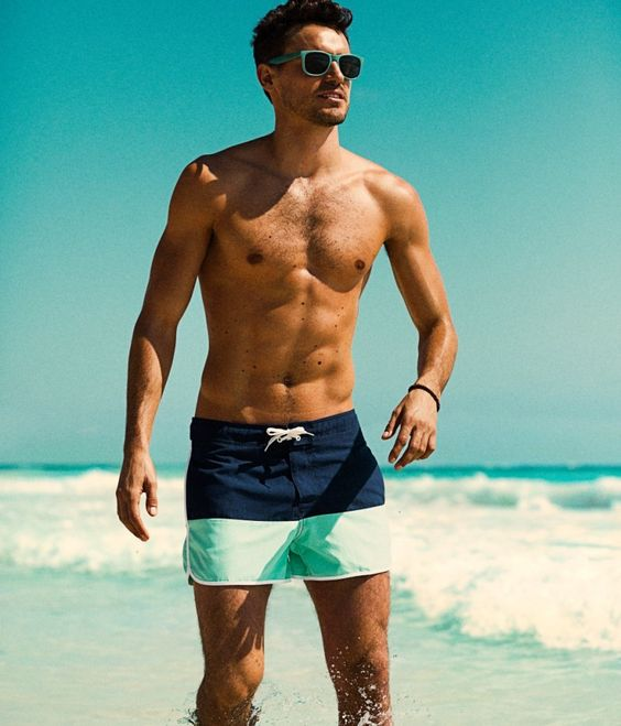bright color block swim trunks with a navy and mint green part is a sporty and bright option