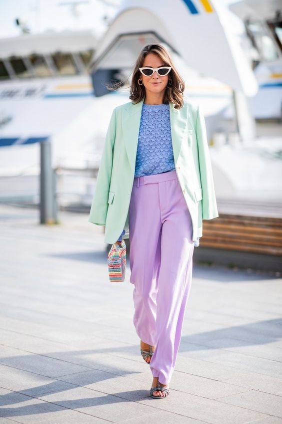 a pastel look with lavenderpants, green shoes, a blue crochet top, an oversized light grene blazer and a colorful bag
