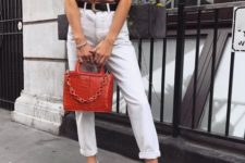 15 a pink oversized tee, white jeans with a black belt, white sneakers and a red bag