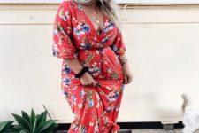 15 a red floral wrap maxi dress is finished off with blakc dad sandals and a cap