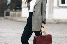 15 a white shirt, black cropped pants, a grey oversized blazer, white sneakers and a burgundy bag
