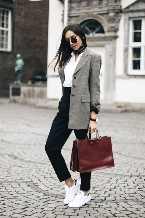a white shirt, black cropped pants, a grey oversized blazer, white sneakers and a burgundy bag