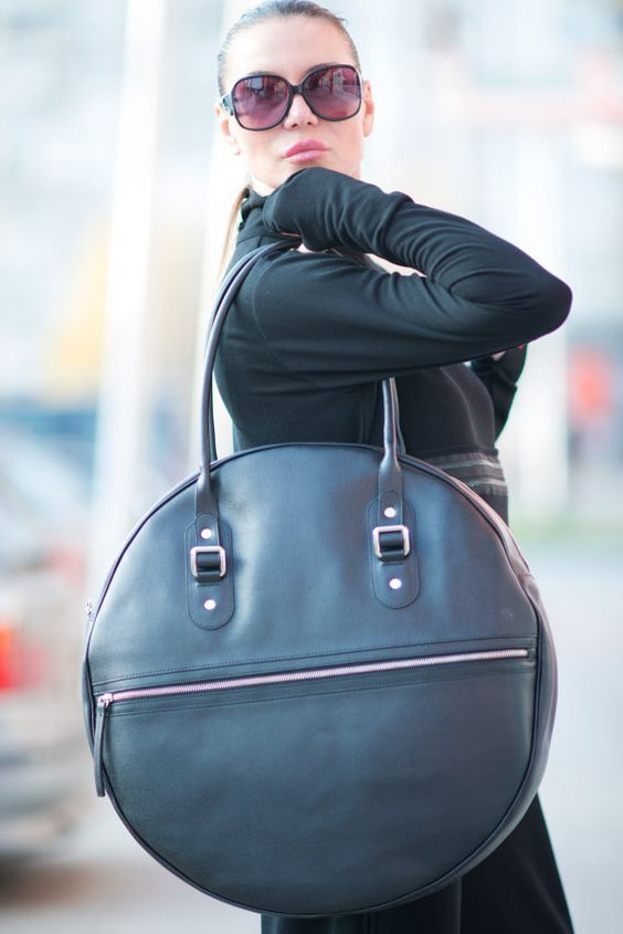 an oversized round bag of black leather is a large take on a very trendy round bag that is currently on