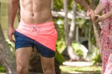 15 coral and navy color block swim trunk with asymmetry is a bright idea to wear this summer