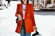 16 a printed tee, pearly denim, white sneakers, an orange oversized blazer and a black bag