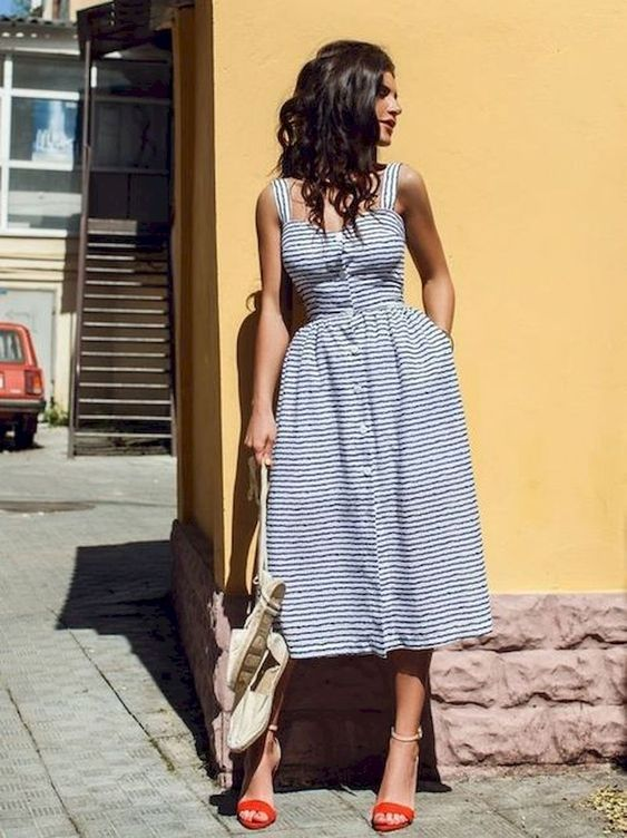 a striped blue and white midi dress with pockets and strap, red shoes for a sexy retro look