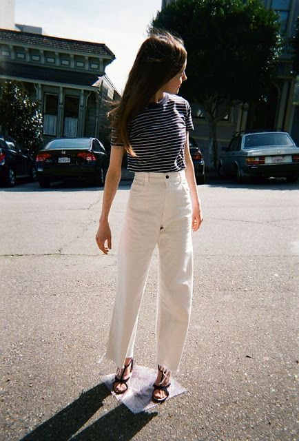 a striped tee, white high waisted mom jeans, black strappy shoes