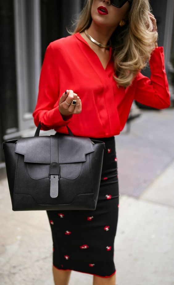 a stylish black bag with a belt on top is work and travel appropriate and will fit most of outfits