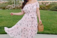 16 a super romantic pink off the shoulder maxi dress with a floral print, slippers and a wooden bag