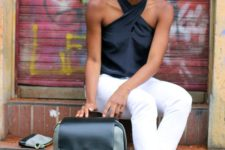 16 a super stylish black and grey backpack for laptops and gold touches looks modern and elegant