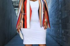 16 a white fitting knee dress, a colorful striped cape and red strappy heels